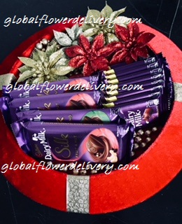 Decorated tray with 4 silk, 10 dairy milk chocolates