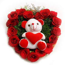 Heart of 24 red roses with teddy in the centre